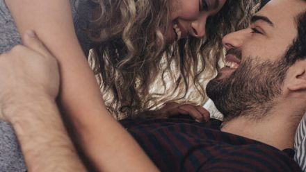 couple trying to get pregnant in bed kissing