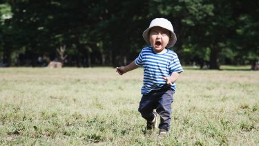 Little boy crying in the park during summer