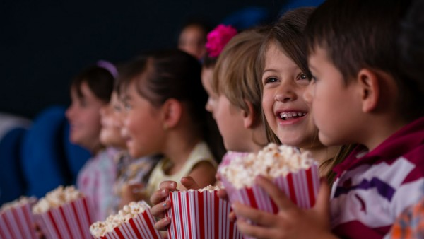Kids with popcorn at the movie