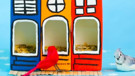 Colourful bird feeders made out of milk cartons