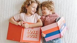 kids laying on the floor with Valentine's Day themed books
