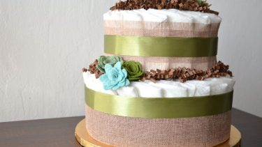 Diaper cake: Two-layered rustic cake made out of diapers and flowers