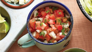 camping cup full of fresh salsa
