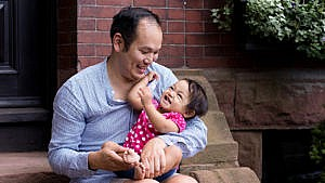 Photo of the author and his daughter sitting on a stoop