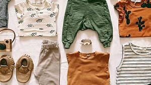 Photo of a spread of kids clothes that are in spring colours