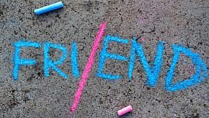 the word friend spelt in blue chalk with a pink line separating FRI and END