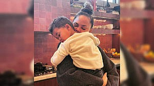 Photo of Chrissy hugging her son Miles