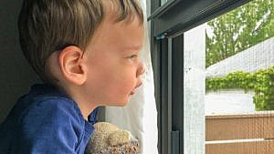 a kid looking out the window